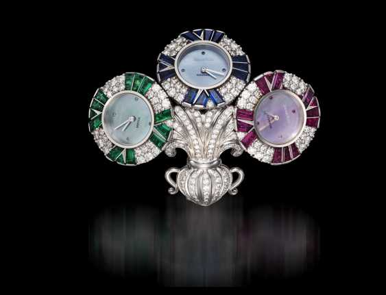 AUDEMARS PIGUET, A UNIQUE GOLD BROOCH WITH 3 QUARTZ WATCHES SET WITH DIAMONDS, RUBIES, SAPPHIRES, AND EMERALDS, ENGRAVED NO. 1 - photo 1