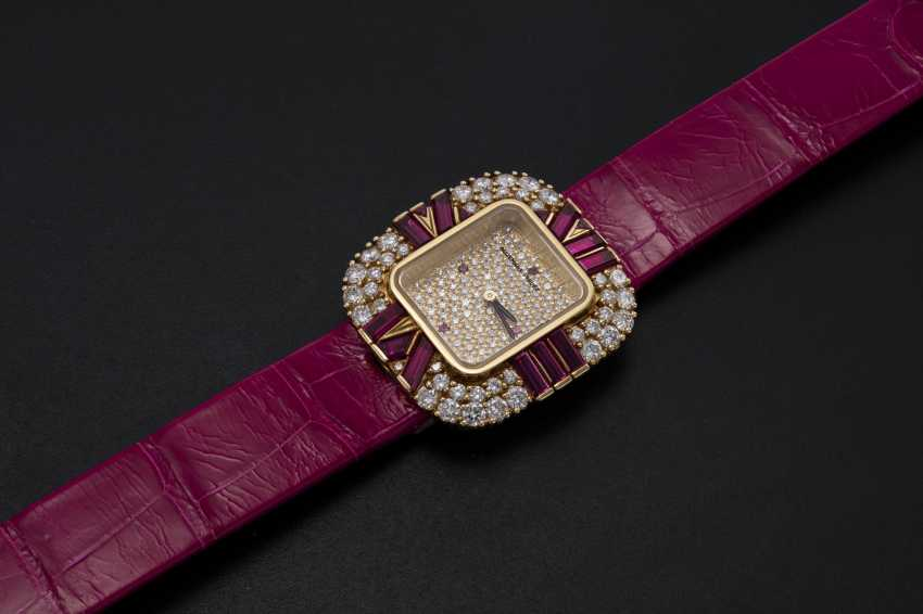 AUDEMARS PIGUET, A LADIES YELLOW GOLD WRISTWATCH SET WITH DIAMONDS AND RUBIES AND A PAVED DIAL - photo 1