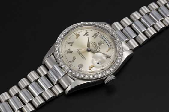 ROLEX, A PLATINUM OYSTER PERPETUAL DAY-DATE WITH DIAMOND-SET BEZEL AND ARABIC CALENDAR AND NUMERALS, REF. 1804  - photo 1