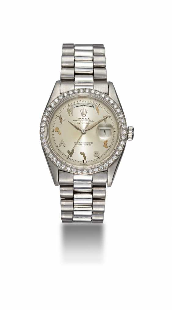 ROLEX, A PLATINUM OYSTER PERPETUAL DAY-DATE WITH DIAMOND-SET BEZEL AND ARABIC CALENDAR AND NUMERALS, REF. 1804  - photo 3