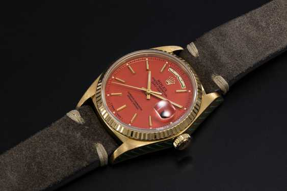 ROLEX, A GOLD OYSTER PERPETUAL DAY-DATE WITH ORANGE STELLA DIAL AND ARABIC CALENDAR, REF. 18038 - photo 1