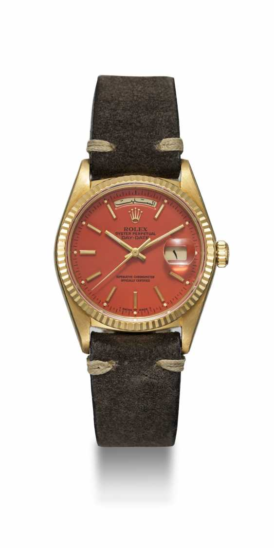ROLEX, A GOLD OYSTER PERPETUAL DAY-DATE WITH ORANGE STELLA DIAL AND ARABIC CALENDAR, REF. 18038 - photo 3