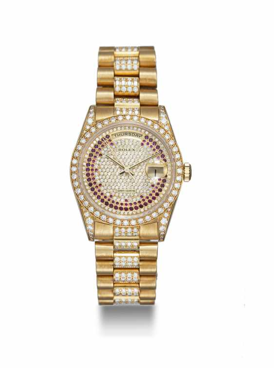 ROLEX, A GOLD OYSTER PERPETUAL DAY-DATE WITH DIAMONDS AND RUBIES, REF. 18388 - photo 3