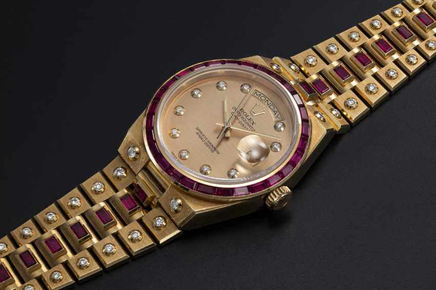 ROLEX. A RARE GOLD OYSTERQUARTZ DAY-DATE, DIAMOND AND RUBY-SET WRISTWATCH AND BRACELET, REF. 19168  - photo 1