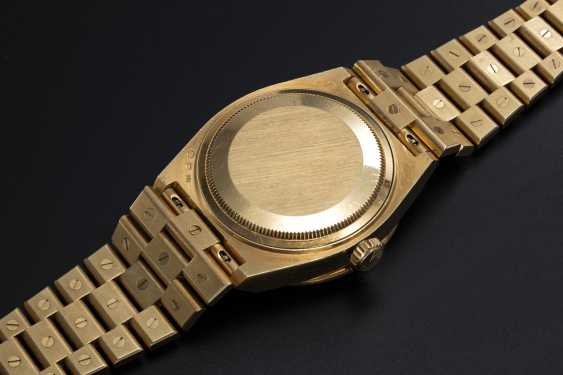 ROLEX. A RARE GOLD OYSTERQUARTZ DAY-DATE, DIAMOND AND RUBY-SET WRISTWATCH AND BRACELET, REF. 19168  - photo 2