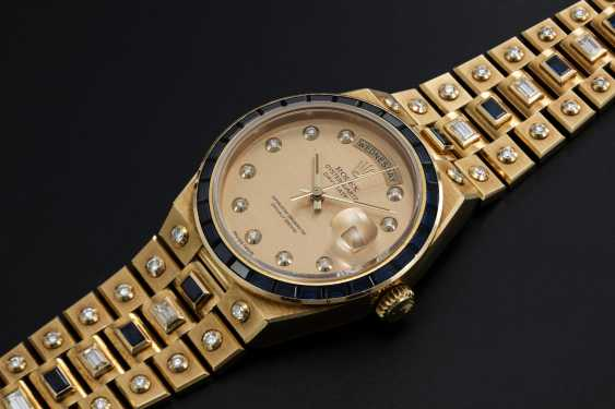 ROLEX, A YELLOW GOLD DAY-DATE OYSTERQUARTZ SET WITH DIAMONDS AND SAPPHIRES, REF: 19168 - photo 1