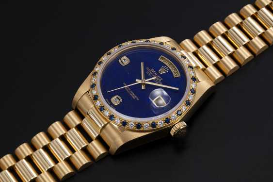 ROLEX, A GOLD OYSTER PERPETUAL DAY-DATE WITH SAPPHIRE AND DIAMOND CRUSTED BEZEL AND LAPIS-LAZULI DIAL, REF. 18148 - photo 1