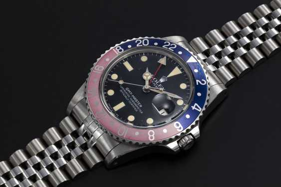 ROLEX, A STAINLESS STEEL OYSTER PERPETUAL GMT-MASTER, REF. 16750 - photo 1