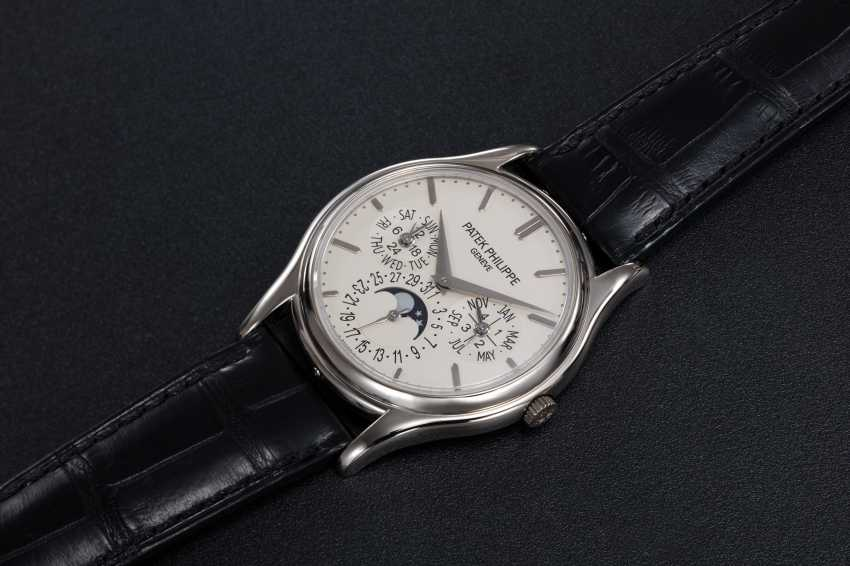 PATEK PHILIPPE, A GOLD PERPETUAL CALENDAR WITH MOON-PHASE, REF. 5140G - photo 1
