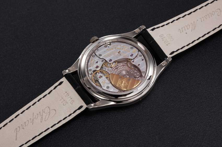 PATEK PHILIPPE, A GOLD PERPETUAL CALENDAR WITH MOON-PHASE, REF. 5140G - photo 2