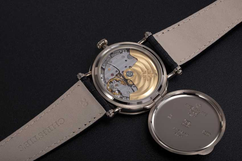 "PATEK PHILIPPE, A GOLD CALATRAVA WRISTWATCH WITH ""OFFICER'S CASEBACK"", REF. 5053G-001 - photo 2"