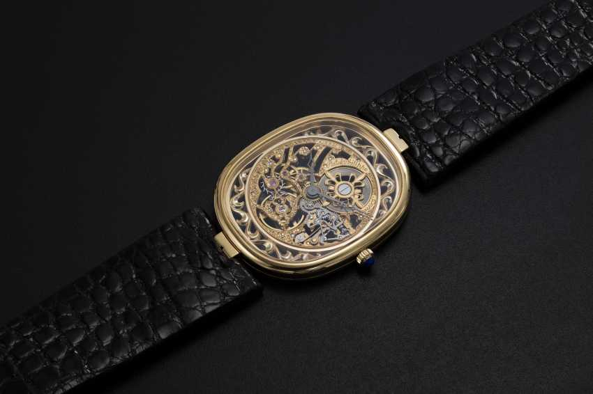 PATEK PHILIPPE, A GOLD ULTRA THIN MANUAL-WINDING SKELETON ELLIPSE WRISTWATCH, REF. 3880 - photo 1