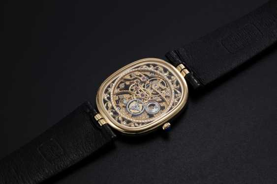 PATEK PHILIPPE, A GOLD ULTRA THIN MANUAL-WINDING SKELETON ELLIPSE WRISTWATCH, REF. 3880 - photo 2