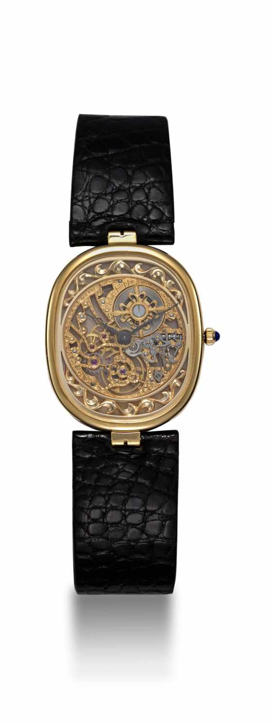 PATEK PHILIPPE, A GOLD ULTRA THIN MANUAL-WINDING SKELETON ELLIPSE WRISTWATCH, REF. 3880 - photo 3