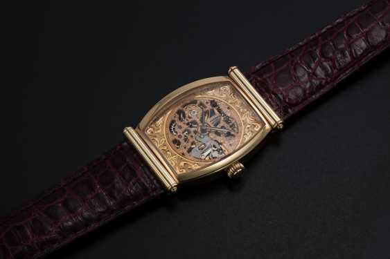 AUDEMARS PIGUET, A GOLD TONNEAU-SHAPED SKELETONISED WRISTWATCH WITH HOODED LUGS, CARNEGIE REF. 15018OR - photo 1