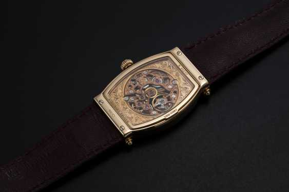 AUDEMARS PIGUET, A GOLD TONNEAU-SHAPED SKELETONISED WRISTWATCH WITH HOODED LUGS, CARNEGIE REF. 15018OR - photo 2