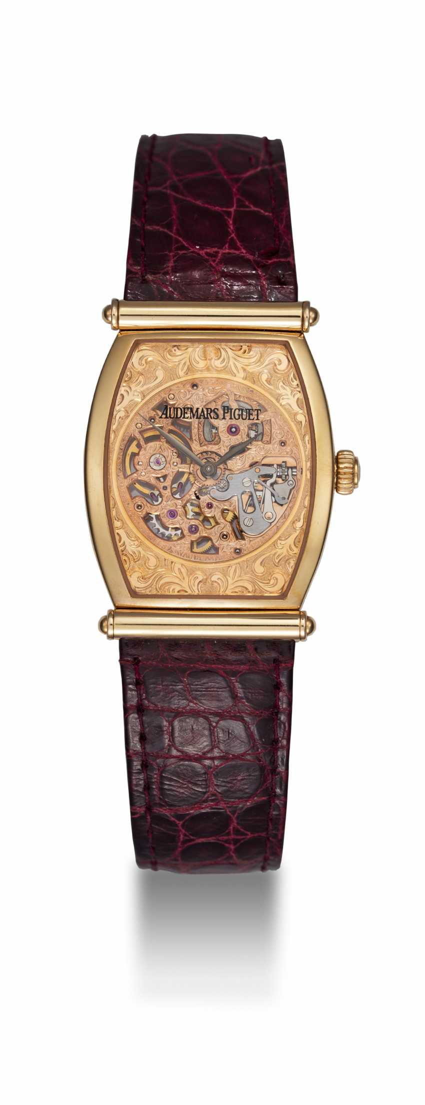 AUDEMARS PIGUET, A GOLD TONNEAU-SHAPED SKELETONISED WRISTWATCH WITH HOODED LUGS, CARNEGIE REF. 15018OR - photo 3