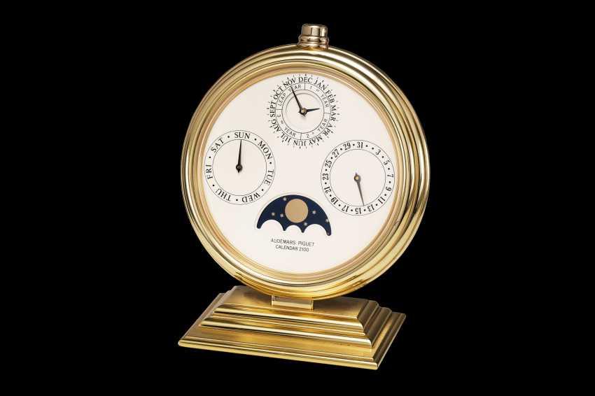 AUDEMARS PIGUET, A GILT BRASS PERPETUAL CALENDAR 2100 DESK CLOCK - photo 1