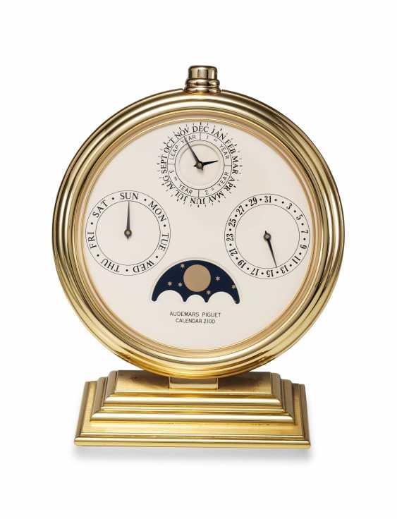 AUDEMARS PIGUET, A GILT BRASS PERPETUAL CALENDAR 2100 DESK CLOCK - photo 3