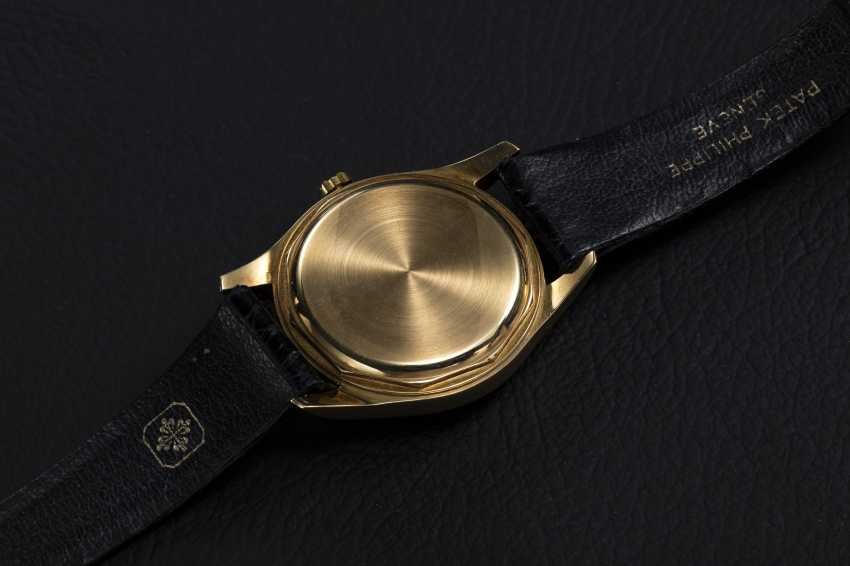 PATEK PHILIPPE, A GOLD SELF-WINDING WRISTWATCH WITH ENAMEL DIAL, REF. 2526 - photo 2