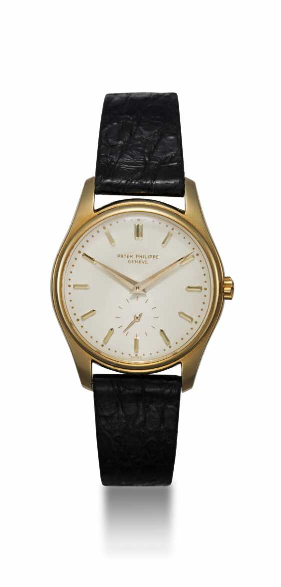 PATEK PHILIPPE, A GOLD SELF-WINDING WRISTWATCH WITH ENAMEL DIAL, REF. 2526 - photo 3
