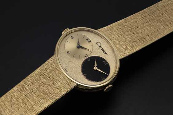 PIAGET, A GOLD DUAL TIME BRACELET WATCH RETAILED BY CARTIER - photo 1
