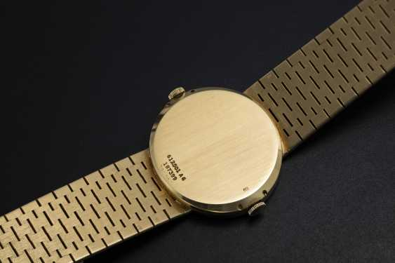 PIAGET, A GOLD DUAL TIME BRACELET WATCH RETAILED BY CARTIER - photo 2