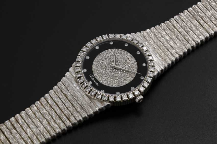 PIAGET, A GOLD SLIM DRESS WATCH WITH ONYX DIAL AND DIAMOND-CRUSTED BEZEL, REF. 12336 - photo 1