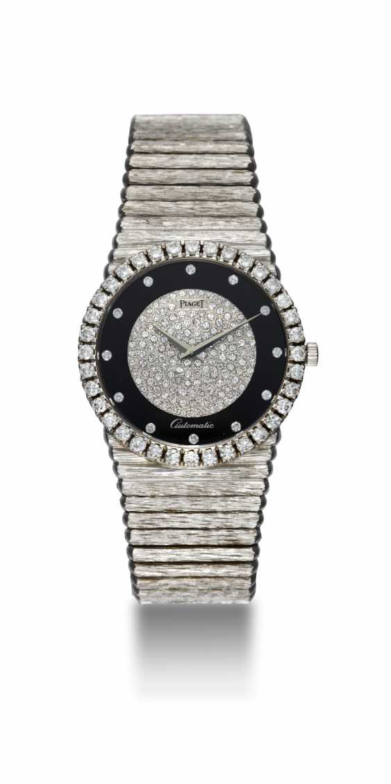 PIAGET, A GOLD SLIM DRESS WATCH WITH ONYX DIAL AND DIAMOND-CRUSTED BEZEL, REF. 12336 - photo 3