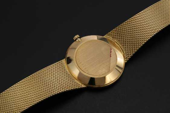 LONGINES, AN ELEGANT GOLD DRESS WATCH WITH THE IRAQI COAT-OF-ARMS - photo 2