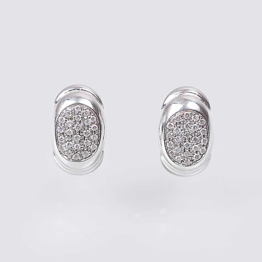 Pair of diamond earrings - photo 1