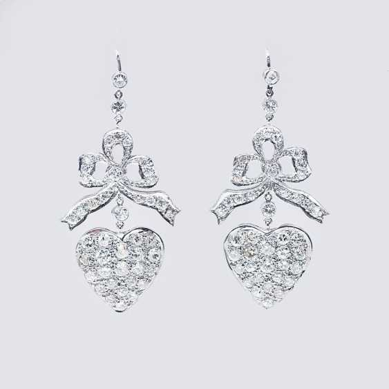 Pair of fine diamond earrings with heart decoration - photo 1