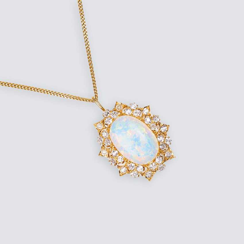 Opal diamond pendant on a chain - photo 1