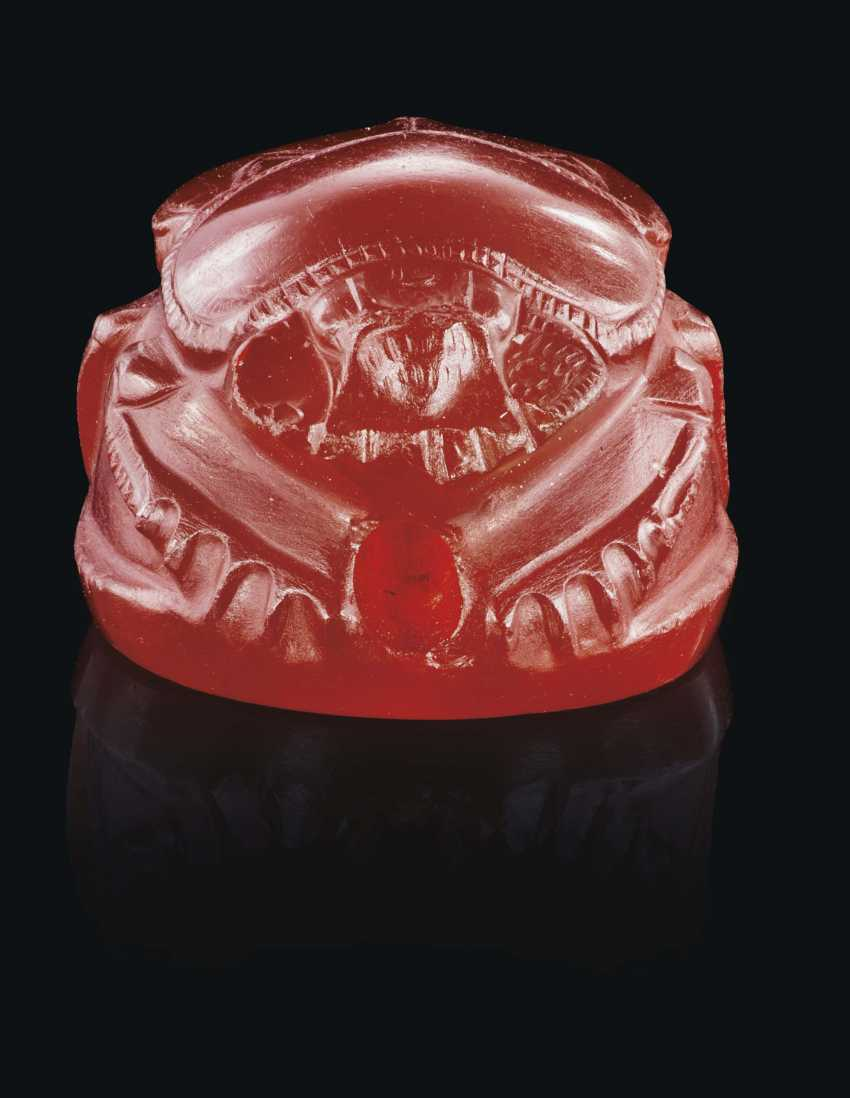 A GREEK CARNELIAN SCARAB WITH A RUNNING YOUTH - photo 4