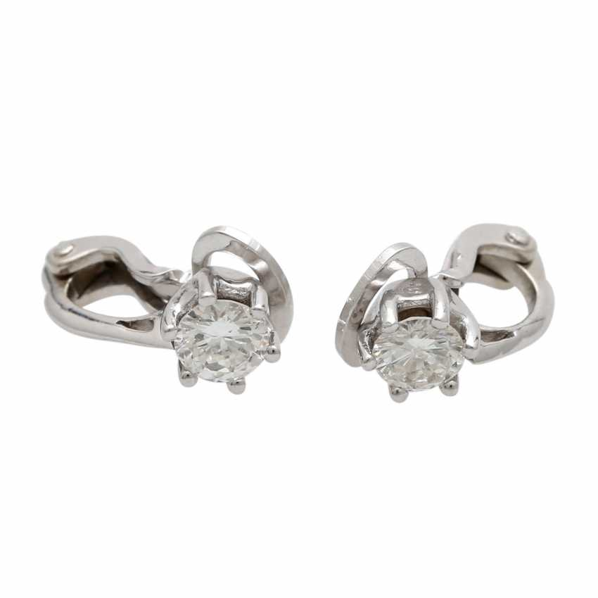 Solitaire clip-on earrings, each with 1 brilliant together approximately 0.8 ct, - photo 1