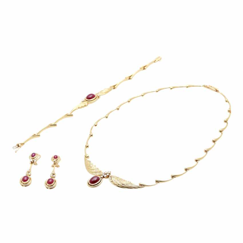 Jewelry with oval-shaped ruby cabochons and diamonds - photo 1