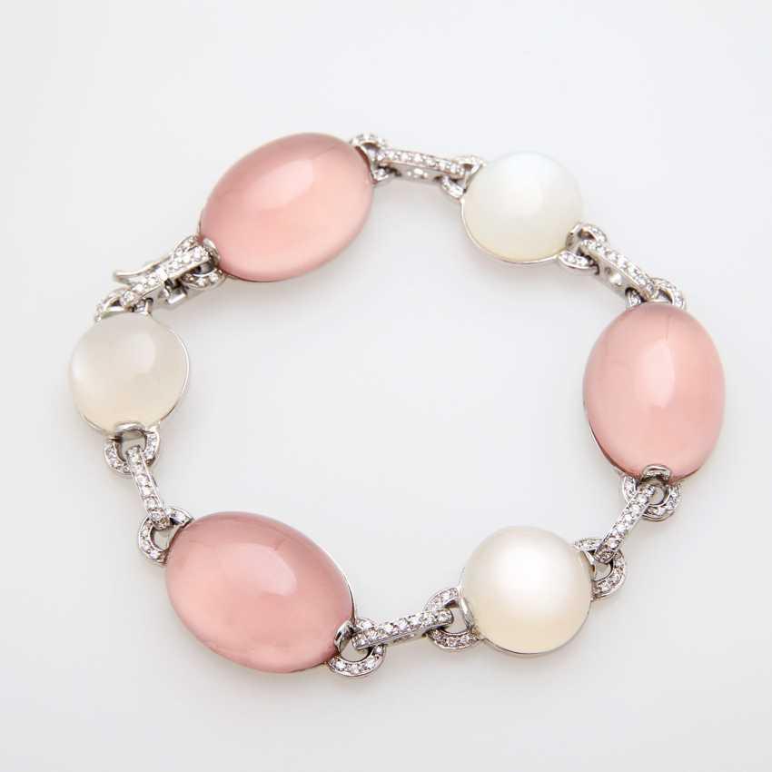 Bracelet made of rose quartz & moon stone Cabochons, - photo 1