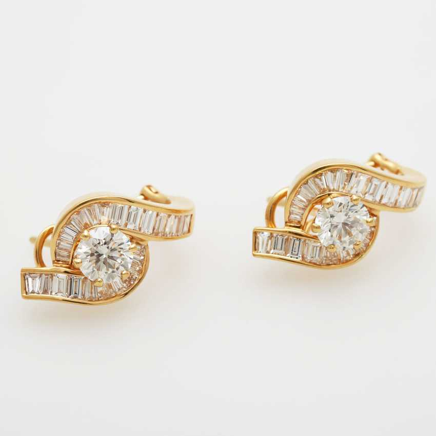 Stud earrings bes. with 1 diamond and 23 diamond trapezoids; - photo 1