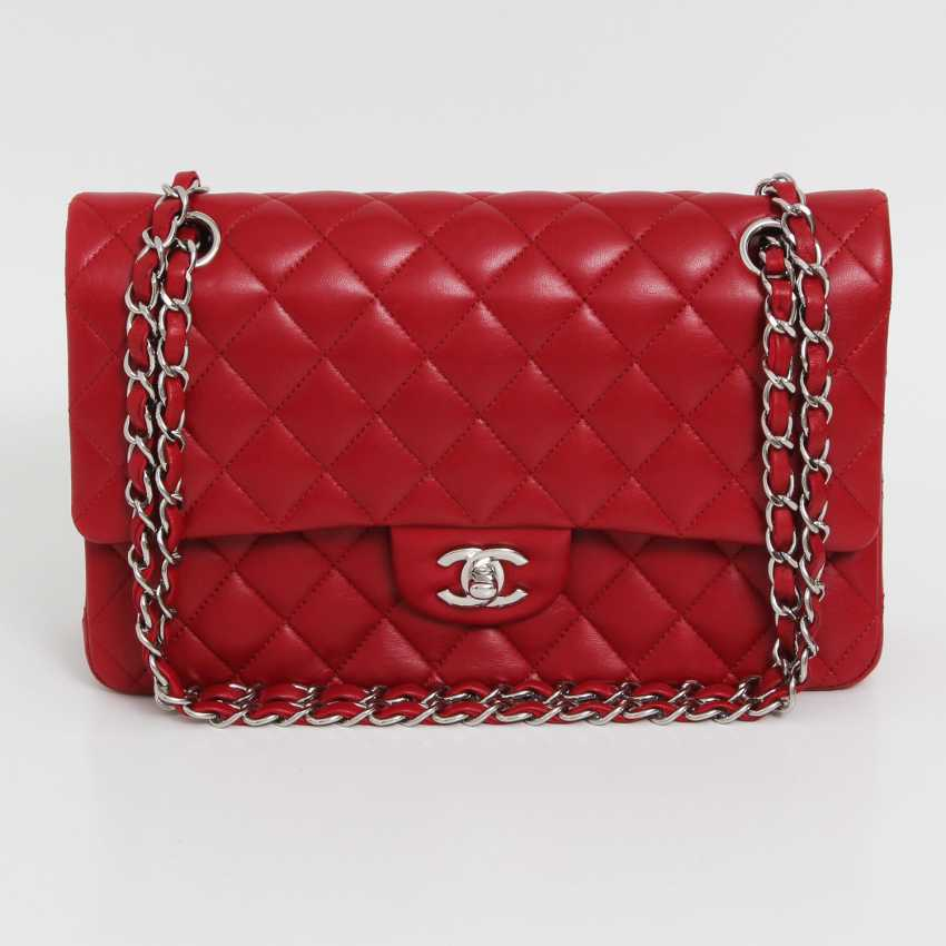 "CHANEL's coveted shoulder bag is a ""CLASSIC DOUBLE FLAP BAG MEDIUM"", - photo 2"
