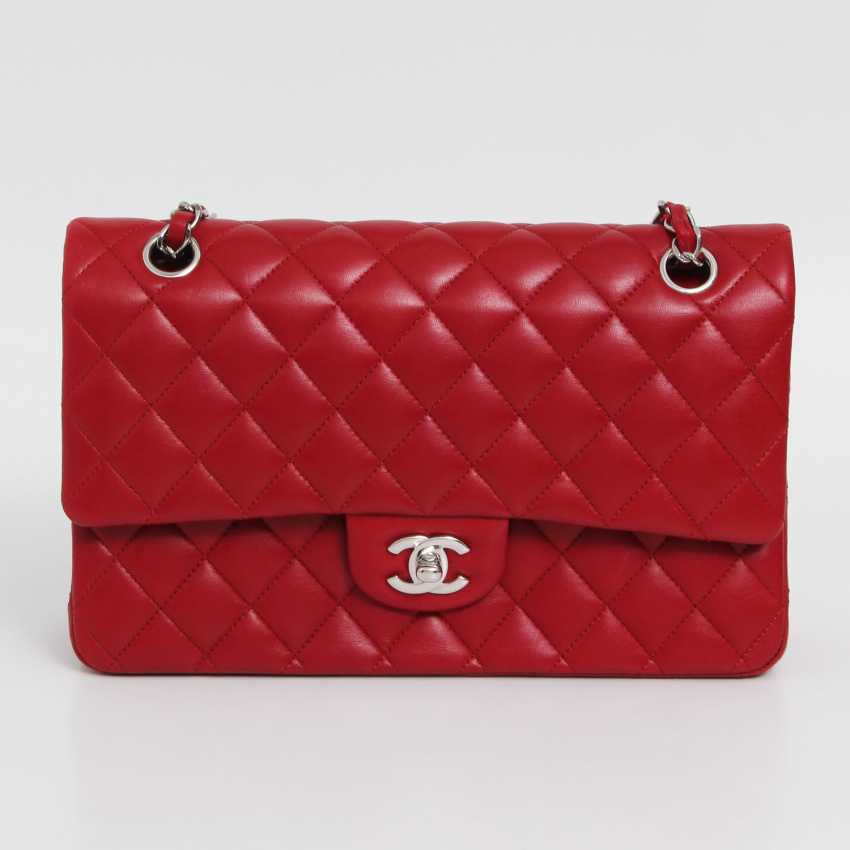 "CHANEL's coveted shoulder bag is a ""CLASSIC DOUBLE FLAP BAG MEDIUM"", - photo 1"