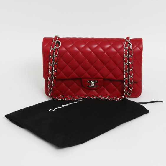 "CHANEL's coveted shoulder bag is a ""CLASSIC DOUBLE FLAP BAG MEDIUM"", - photo 6"