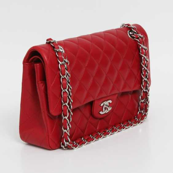 "CHANEL's coveted shoulder bag is a ""CLASSIC DOUBLE FLAP BAG MEDIUM"", - photo 3"