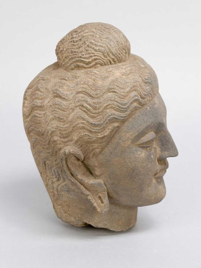 Ancient Indian stone head of a goddess