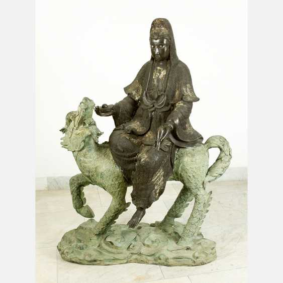 Large Asian bronze group of Guanyin