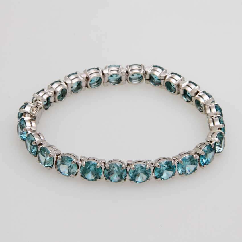 Bracelet studded with rundfac. Zircons - photo 1