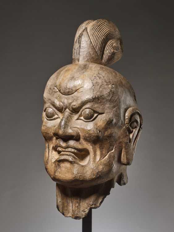 OVER-LIFESIZE LIMESTONE HEAD OF A TIANWANG GUARDIAN GOD, CHINA, TANG DYNASTY - photo 1
