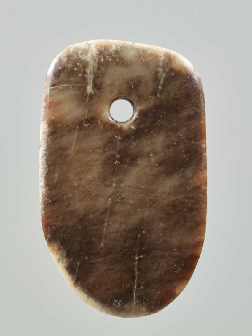 A LEVIGATED, AMBER-COLOURED JADE FU AXE WITH A SMOOTH CONTOUR AND A ROUND EDGE - photo 1