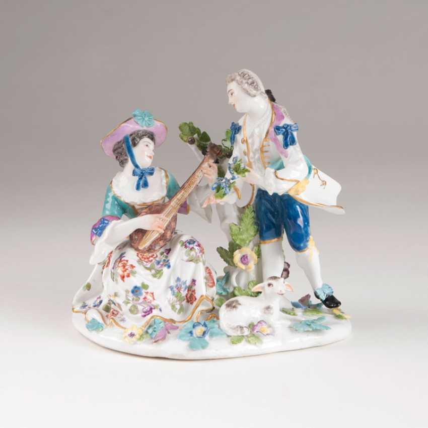 Porcelain figure group Gallant shepherd couple with Lute'. - photo 1