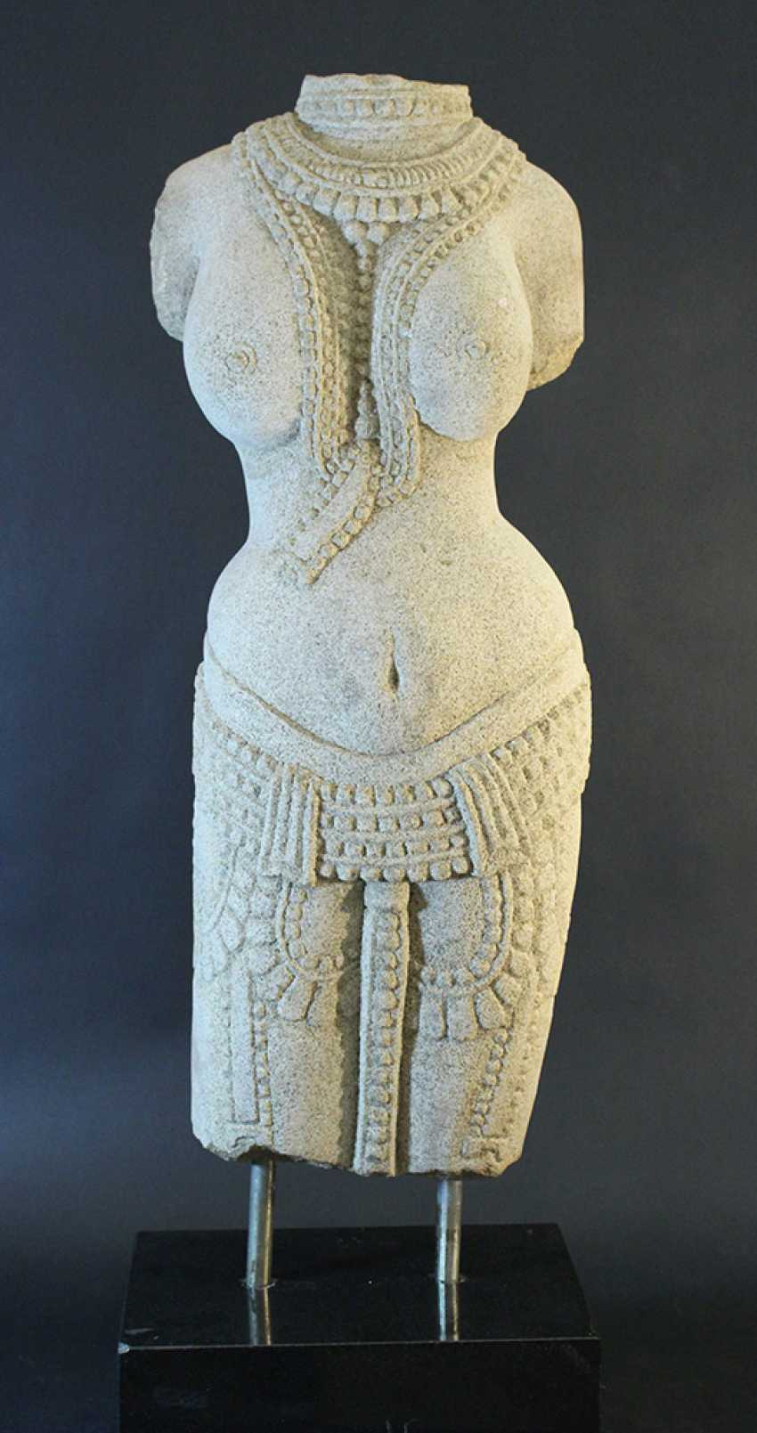 Indian stone scultpure of a female torso with necklaces and jewelry around the hips - photo 1