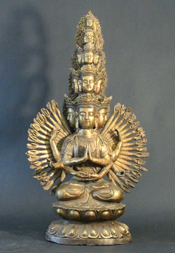 Tibetian Avalokitesvara with thousand arms and nine heads and crowned by a grotesque face and a Buddha's head - photo 1